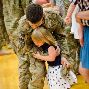 The daughter of my daughter in my story. At the age of 5, she is welcoming home her daddy from his most recent deployment. She is as tough as her momma.